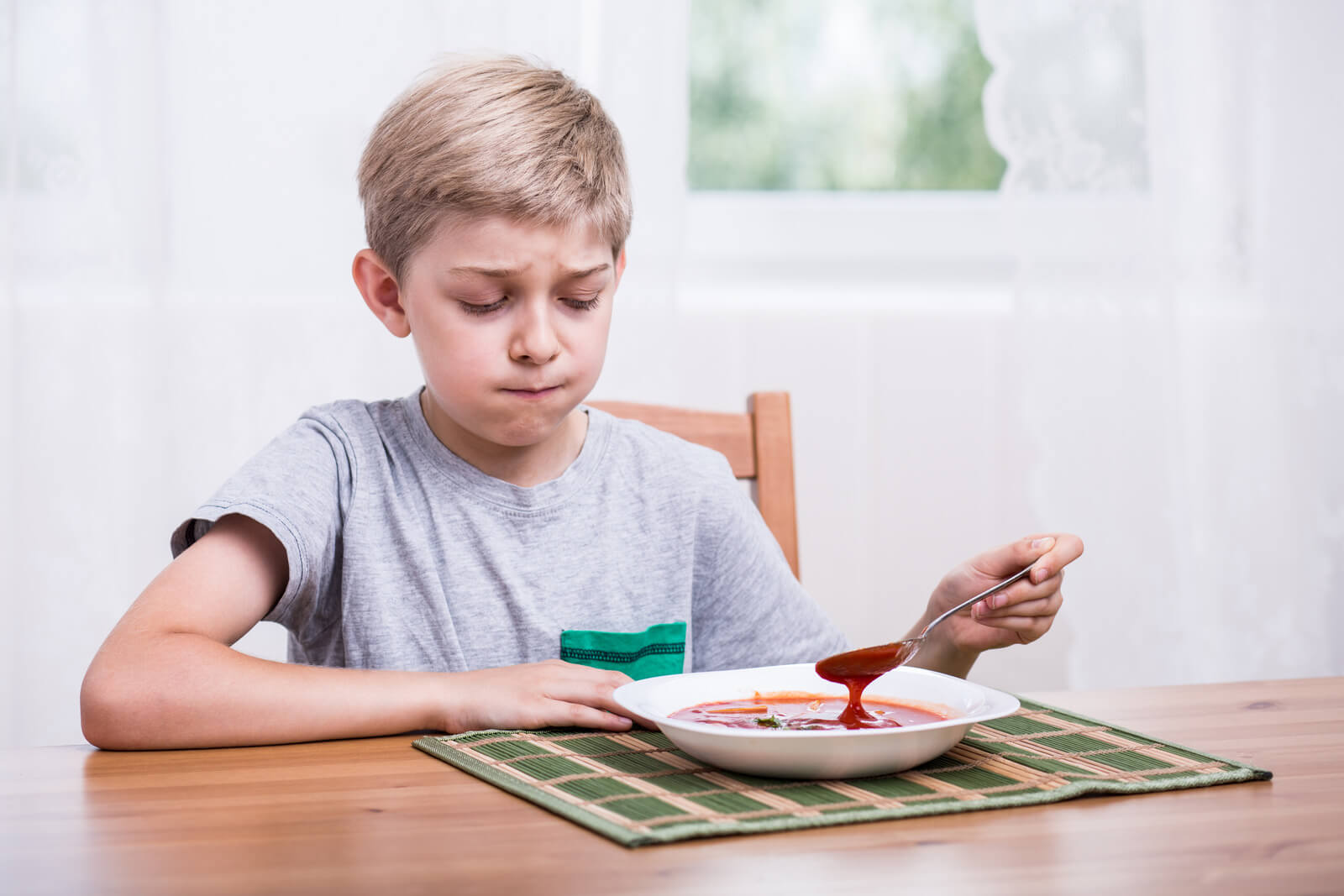 young child scoffs at food obvious picky eater