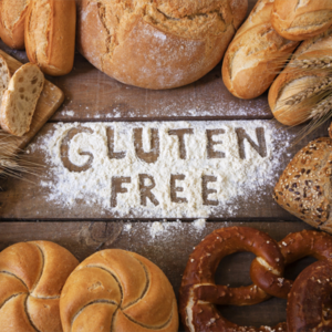 different types of bread surrounding flour spelling out gluten free