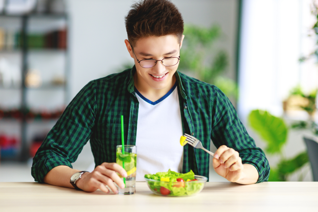 man with eating disorder getting nutrition from salad