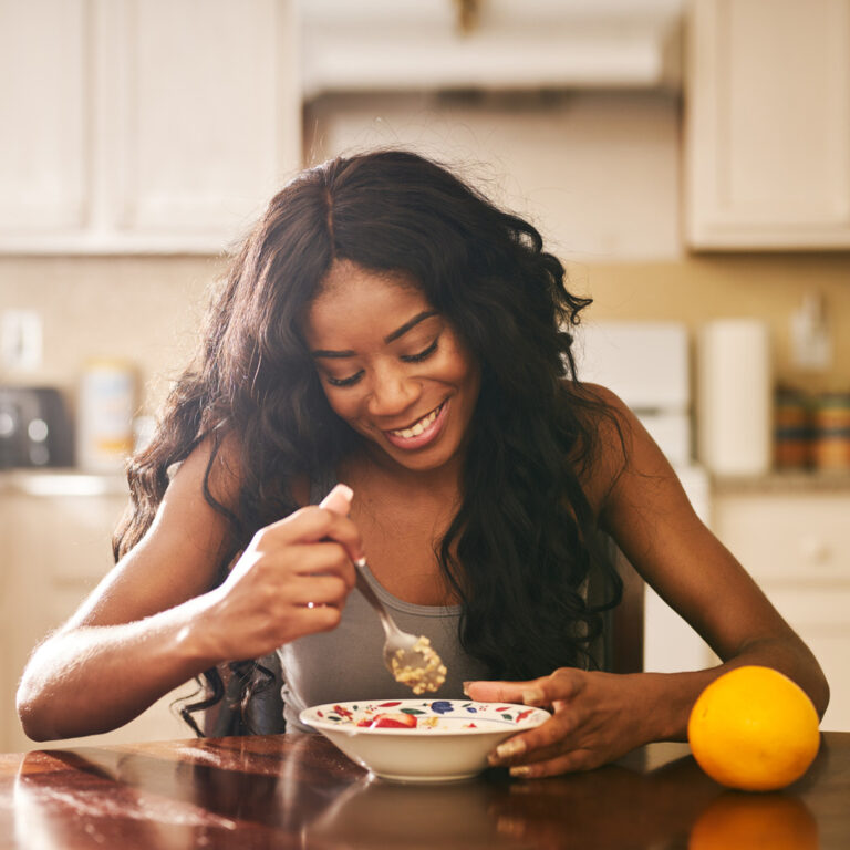 woman with eating disorder eats breakfast recommended by dietitian