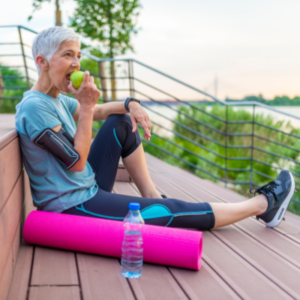 athletic woman resting during excercise to hydrate and consume nutrients